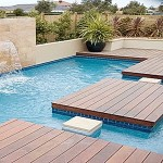 Stunning Wooden Style Deck Small Swimming Pool Melbourne with Unique Design and Great Fountain Design and Green View